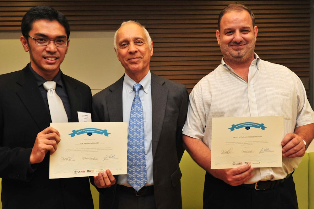 USAID RDMA Director Michael Yates (center) with Mobile Solutions M4D Contest Award Winners Javier Sola of the Open Institute, first place (right)